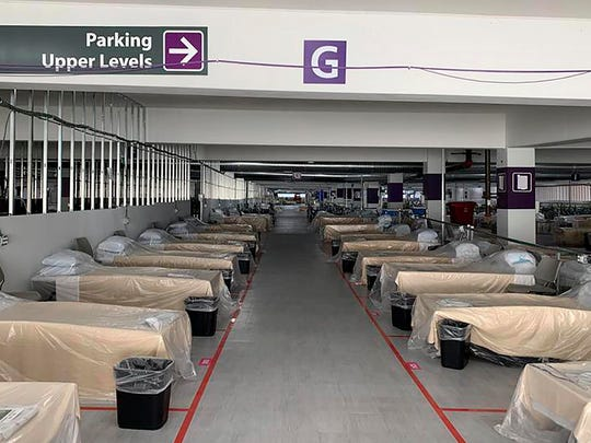 Hospital beds sit inside Renown Regional Medical Center's parking garage, which has been transformed into an alternative care site for COVID-19 patients, in Reno, Nev., on Nov. 11.
