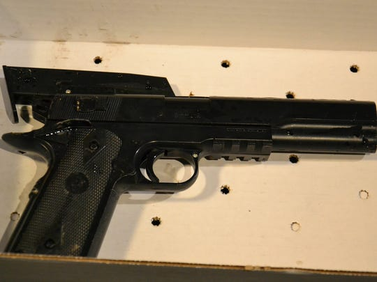 "This Saturday, Nov. 22, 2014 photo of a BB gun taken from a 12-year old shot by Cleveland police is shown. A 12-year-old boy shot by police after apparently grabbing what turned out to be a replica gun died from his wounds Sunday, a day after officers responded to an emergency call about a someone waving a ""probably fake"" gun at a playground. One officer fired twice after the boy pulled the fake weapon, which was lacking the orange safety indicator usually found on the muzzle, from his waistband but had not pointed it at police, Deputy Chief Ed Tomba said. (AP Photo/The Plain Dealer, Cory Schaffer)"