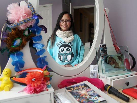 Thirteen-year-old cancer survivor Kaela Cruz, Thursday, January 29, 2015, in her bedroom in Sayreville, NJ. Jason Towlen/Staff Photographer