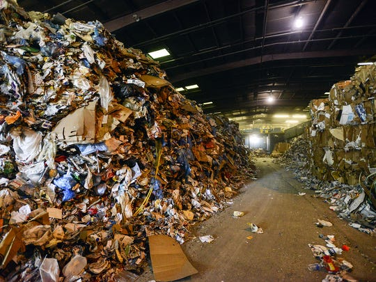In this file photo, piles of plastic, glass, aluminum and cardboard sit inside the Curbside Management recycling center in Woodfin, in August 2014. Curbie, handles recycling for the city of Asheville and its 30,000 customers, as well as for Fletcher, Woodfin and Weaverville. The piles represent about three days worth of recycling for the center, said president and founder Barry Lawson.