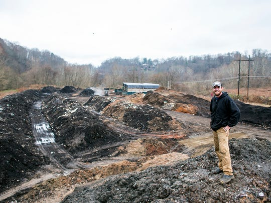 Danny Keaton stands above his composting operation, Danny's Dumpsters in East Asheville. Keaton started collecting food waste from restaurants in Madison County with a pickup truck seven years ago. Now his operation collects 35-40 tons of food waste from 120 Asheville-area businesses. Keaton sells compost made from the waste.