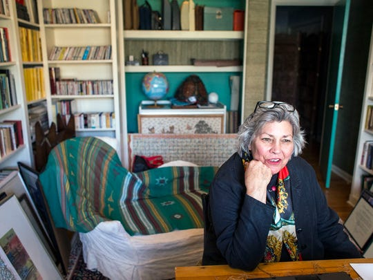 Liz Colton talks about her travels in her office at her South Asheville home. The former foreign correspondent has spent her working life in newspapers, radio, television, diplomacy and more, mostly working abroad and often as the only women working overseas in the 1970s and '80s.