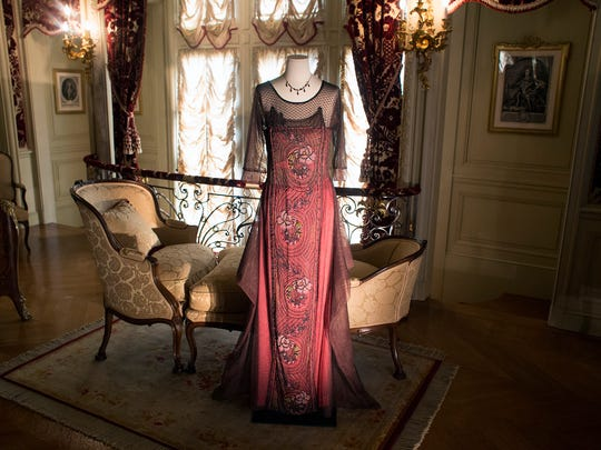 "One of 47 costumes from ""Downton Abbey"" is on display in the Louis XV room at Biltmore House. The exhibit runs through May 31."