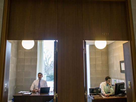 Rep. Brian Turner, D-Buncombe, left, works in his office