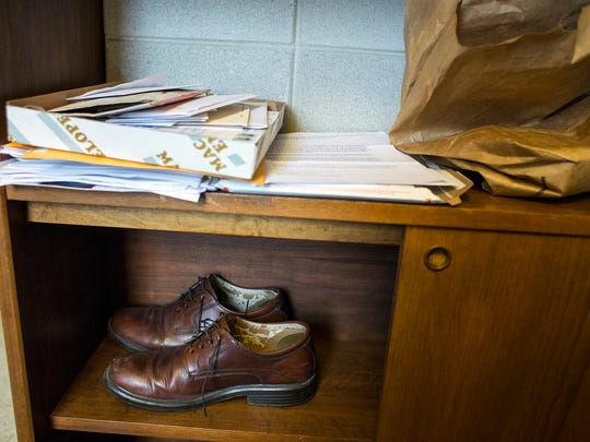 Rep. John Ager's shoes sit on a shelf in his new office