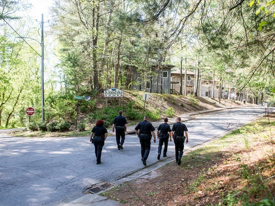 Members of the Asheville Police Department's Housing Division started regular walk-throughs at Klondyke Homes last week. Residents of the city's subsidized housing communities have struggled to get along with police in recent months, but are working together with police to improve relationships and make communities safer.