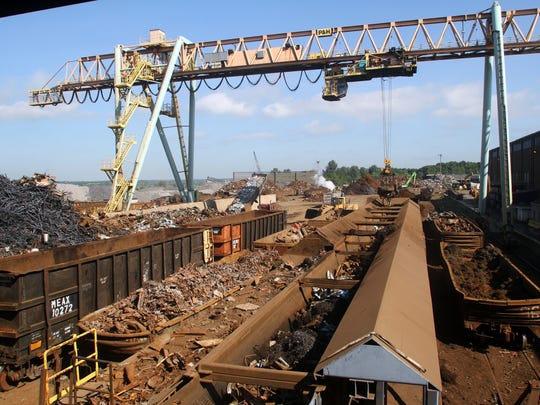 Scrap metal is loaded onto a conveyor prior to being recycled in to rebar at Gerdau Long Steel North America's Sayreville Mill, Tuesday, August 19, 2014, in Sayreville, NJ. Photo by Jason Towlen