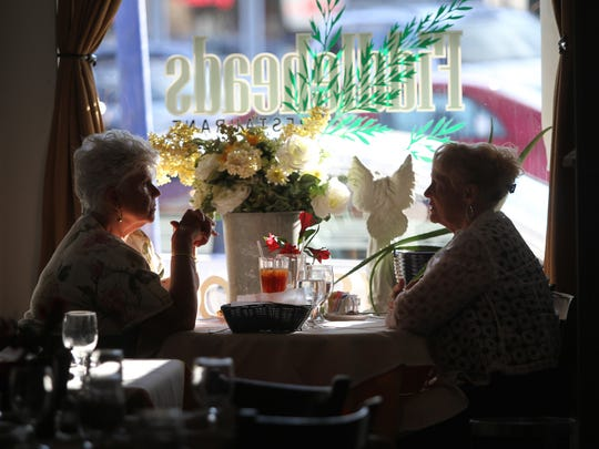 Diners in the window seat at Fiddleheads Restaurant, Thursday, August 28, 2014, in Jamesburg, NJ. Photo by Jason Towlen