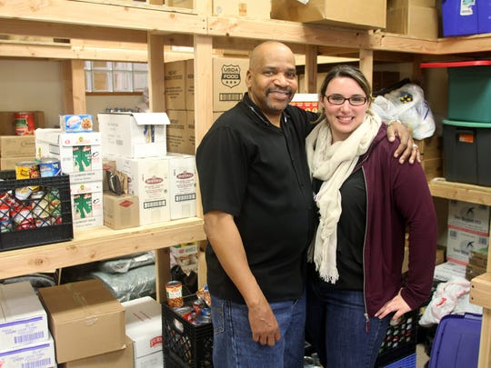 Elijah's Promise social service coordinator Robert Mason and volunteer and donations coordinator Kaitlynn Deal are pictured at the New Brunswick-based organization's headquarters on Nov. 25.