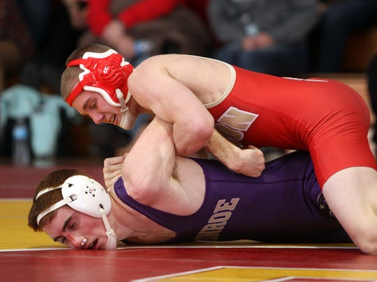 Shawn Gardini of Monroe wrestles Robert Cleary of Edison in the 120lb match, Wednesday, January 14, 2015, in Edison, NJ. Jason Towlen/Staff Photographer