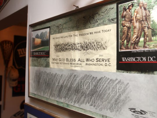 Rubbings of Fred Bonner's name from the Vietnam memorials in Washington, D.C., and Holmdel hang in his brother Mike Bonner's Old Bridge home.