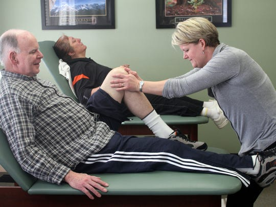 Physical therapist Kristin Wishnow, right, treats James Barry of Hillsborough, Wednesday, February 11, 2015, at Total Care Physical Therapy, P.C. in Hillsborough, NJ. In the background is patient Fran Wierzbinski of Belle Mead. Jason Towlen/Staff Photographer