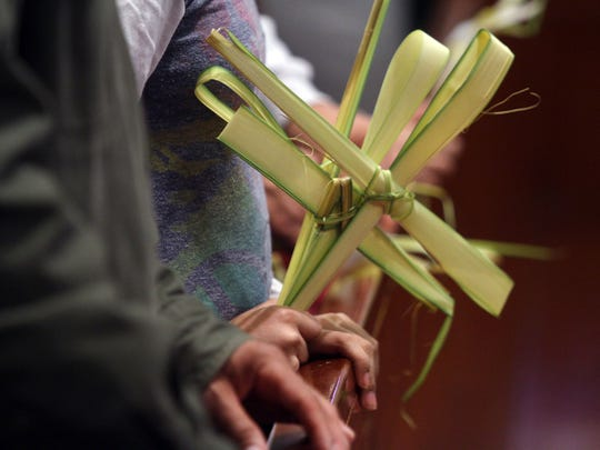 Parishioners hold palms during Palm Sunday Mass at the Cathedral of Saint Mary of the Assumption, Sunday, March 29, 2015, in Trenton, NJ.