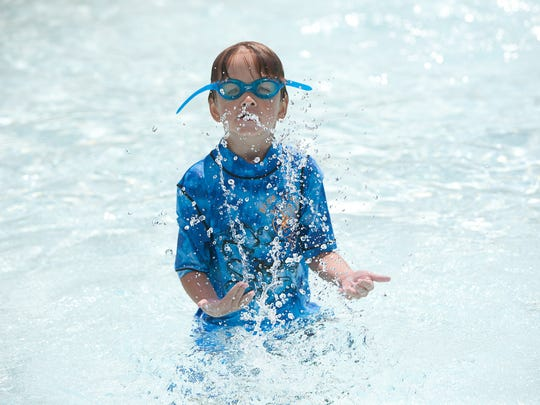 Ethan Luft, 6, of West Des Moines splashes around in the pool at the Holiday Park Aquatic Center on July 27, 2012. Holiday Park Aquatic Center will open for the 2014 season on Monday, the city said. A broken pipe prevented the pool from opening earlier.