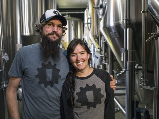 Chip Owen, left, and Nicole Dexter, co-founders and owners of Innovation Brewing in Sylva, stand together in an Asheville brewery Monday, March 9, 2015. The pair are in a copyright dispute with Bells Brewing in Michigan over their name. Picture taken by Katie Bailey/bkbailey@citizen-times.com