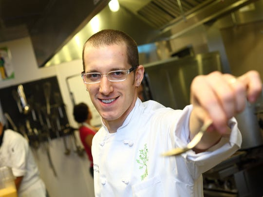 """James Rigato, chef at The Root in White Lake Township, is one of 16 national chefs competing for the title of Bravo's """"Top Chef."""""""