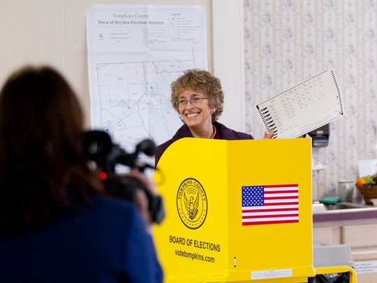 Martha Robertson show off her ballot Tuesday morning