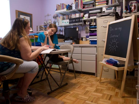 Lynda Rowley, left, and daughter, Karalynn, 13, go over the day's mathematics lesson. Rowley likes the flexibility of home-schooling.