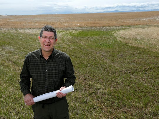 Brett Doney, president and CEO of Great Falls Development Authority, stands in a 20-acre field on the east end of 10th Avenue South where an 186,933-square foot new big box store will be built. Groundbreaking is delayed until 2015.