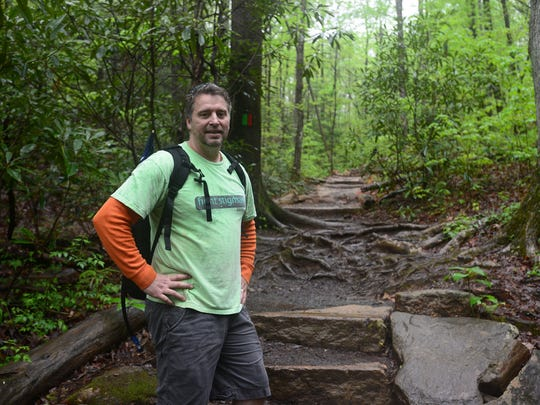 Paton Blough hikes Table Rock State Park for the ninth day in a row on Tuesday. He is planning on climbing Table Rock everyday until a bill providing funding to mental health courts is passed.