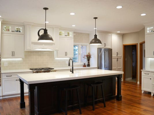 island features thick cambria top in kitchen redone by the affordable compa.jpg