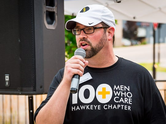 100+ Men Who Care Hawkeye Chapter board member Leighton Smith makes announcements during the group's third quarter meeting at Backpocket Brewery in Coralville on Aug. 28.