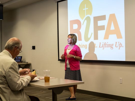 Amy Crenshaw speaks about the 10th annual Canstruction project during the Regional Inter-Faith Association's media luncheon Tuesday at the LIFT Center in downtown Jackson.