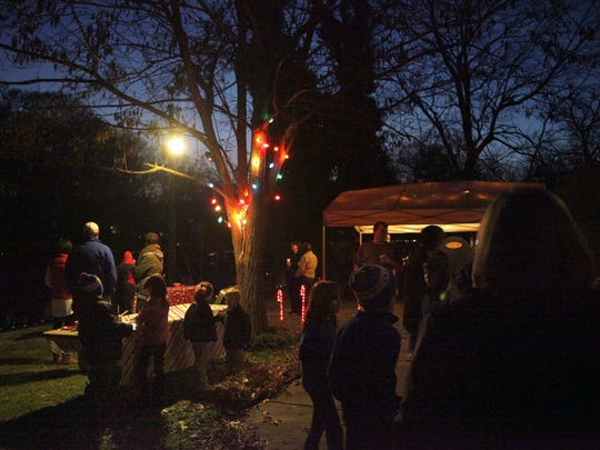 Families gather for the lighting of Campbell Lake and the LANA Holiday Home Tour in this 2012 file photo.