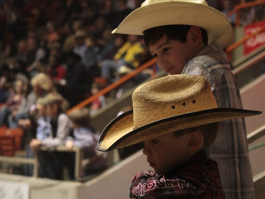 Young bull riding fans watch as the riders make their