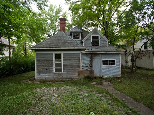The home at 617 New York Street Friday, September 12, 2014, in Lafayette. The Lafayette Hearing Authority on Tuesday, Sept. 9,  postponed a vote to place the house on the unsafe structures demolition list, creating more time to find a buyer.
