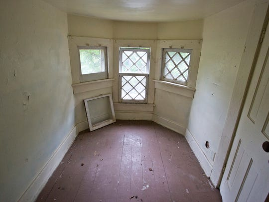 Inside of the home at 617 New York Street Friday, September 12, 2014, in Lafayette. The Lafayette Hearing Authority on Tuesday, Sept. 9,  postponed a vote to place the house on the unsafe structures demolition list, creating more time to find a buyer.
