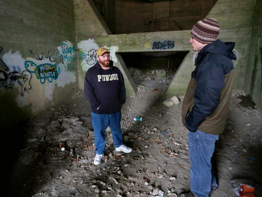 Chris Galbreth, left, talks with volunteer Patrick Ringwald as they search the U.S. 52 overpass while conducting the Point in Time homeless count Wednesday, January 28, 2015, near the former Lafayette Golf Course. The location is known to be frequented by homeless. Local homeless service agencies work together for the Point in Time homeless count, which is taken each January to assess the number of homeless in the area. The survey is required for federal funding. Galbreth is housing care manager with Wabash Center.