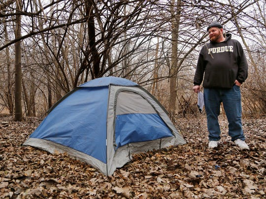 Chris Galbreth checks a tent pitched in a thicket near Lyboult Park while conducting the Point in Time homeless count Wednesday, January 28, 2015, in Lafayette. Nobody was found in or near the tent. Local homeless service agencies work together for the Point in Time homeless count, which is taken each January to assess the number of homeless in the area. The survey is required for federal funding. Galbreth is housing care manager with Wabash Center.