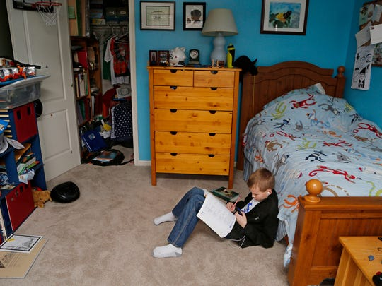 Jonathan Putman, 11, works on sixth grade math in his bedroom Monday, November 24, 2014, in his Lafayette. An upstairs room serves as the homeschooling classroom for all four Putman children.