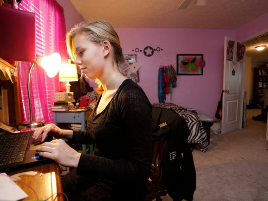 Abigail Putman, 14, works on Algebra 1 lessons in her bedroom Monday, November 24, 2014, in her Lafayette home. An upstair room serves as the homeschooling classroom for Putman along with her sister and two brothers. Abigail's mother, Cara Putman, was homeschooled as a child growing up in Nebraska.