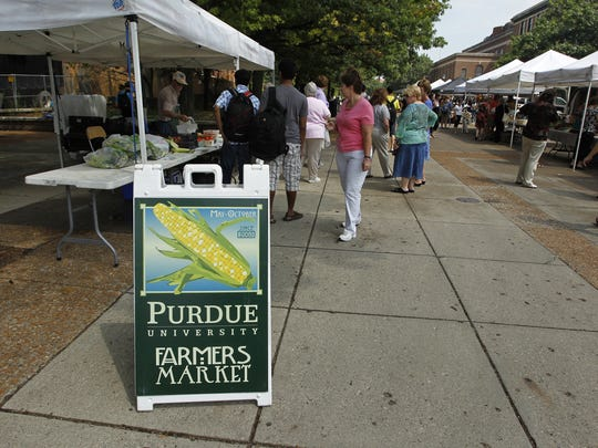 The Purdue campus farmers marketis located at the Centennial Mall and draws a large lunch crowd.
