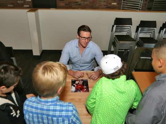Detroit Red Wings goalie Jimmy Howard signs autographs for fans as part of a charity appearance at Mt. Brighton last week.