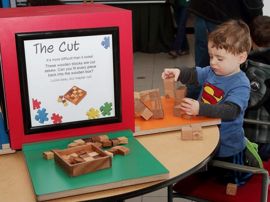 """Jacob Epstein, 2, plays with wooden blocks at one of the """"Mind Benders"""" stations at the Morris Museum in Morris Township on Saturday."""