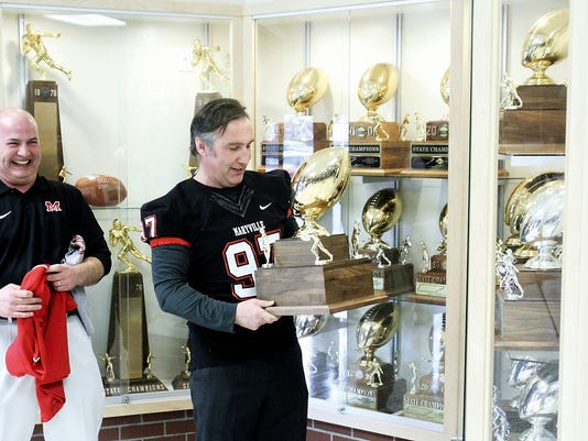 Williamson County Director Places Trophy Into Winning Schools Trophy Case