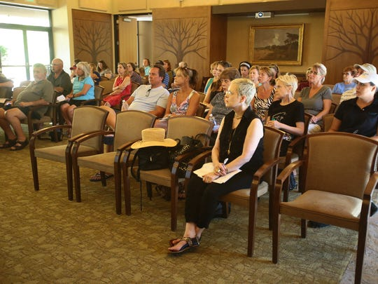 "People attend a presentation by Lynsey White Dasher entitled ""Solving Problems with Coyotes in Palm Desert"" on Tuesday, July 15, 2014 at The Living Desert Zoo & Gardens in Palm Desert, Calif."