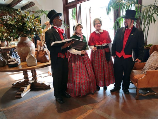 Desert Carolers members (from left) Jesse L. Martin, Jo Nell Bevington, Theresa Danne, and Mario Rios sing holiday music inside the Ralph Lauren store while performing at The Shops on El Paseo on Sunday, December 21, 2014 in Palm Desert, Calif.