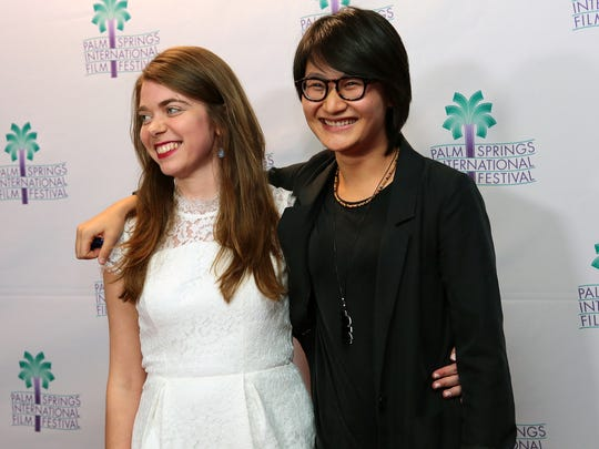 "Two of the ""Don Quixote: the Ingenious Gentleman of La Mancha"" co-directors, Alana Waksman and Xu Zhang, walk the red carpet before the film's screening on Wednesday, January 7, 2015 during the Palm Springs International Film Festival in Palm Springs, Calif."