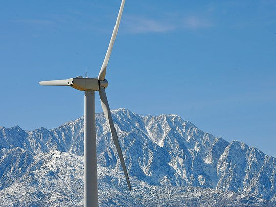 A wind turbine generates electricity near Desert Hot