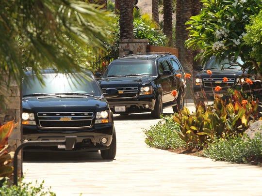 A caravan of black SUVs leaves Porcupine Creek, the golf estate owned by Oracle CEO Larry Ellison, on Sunday, June 15, 2014 in Rancho Mirage, Calif..