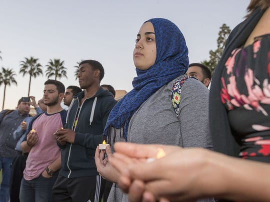 Zana Alattar, 20, president of Students Organize for Syria (center), attends The Muslim Liberty Project's candlelight vigil in honor of victims of ISIS at the Hayden Lawn, ASU Tempe Campus on Monday, February 9,2015. ASU students and proud Americans representing all faiths will gather to honor those who have fallen victim to ISIS savagery, and to pray for the demise of ISIS. Among others, this vigil will recognize ISIS hostage Kayla Mueller, an aid worker from Prescott, AZ who was taken hostage by ISIS in Aleppo on August 4, 2013.