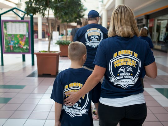 Stacy and Carl Palma of Greece participate in a community charity walk hosted by Operation Patriot Foundation at the Mall at Greece Ridge on Saturday.