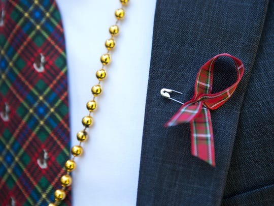 Dr. Joe Catania wears a plaid ribbon and tie. Dr. Subtelny was known for his plaid suit he wore at his Christmas parties.