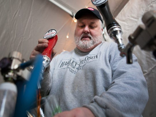 Genesee Brewery brewmaster Dean Jones fills a pint at the Homegrown festival at Lovin' Cup in 2015.
