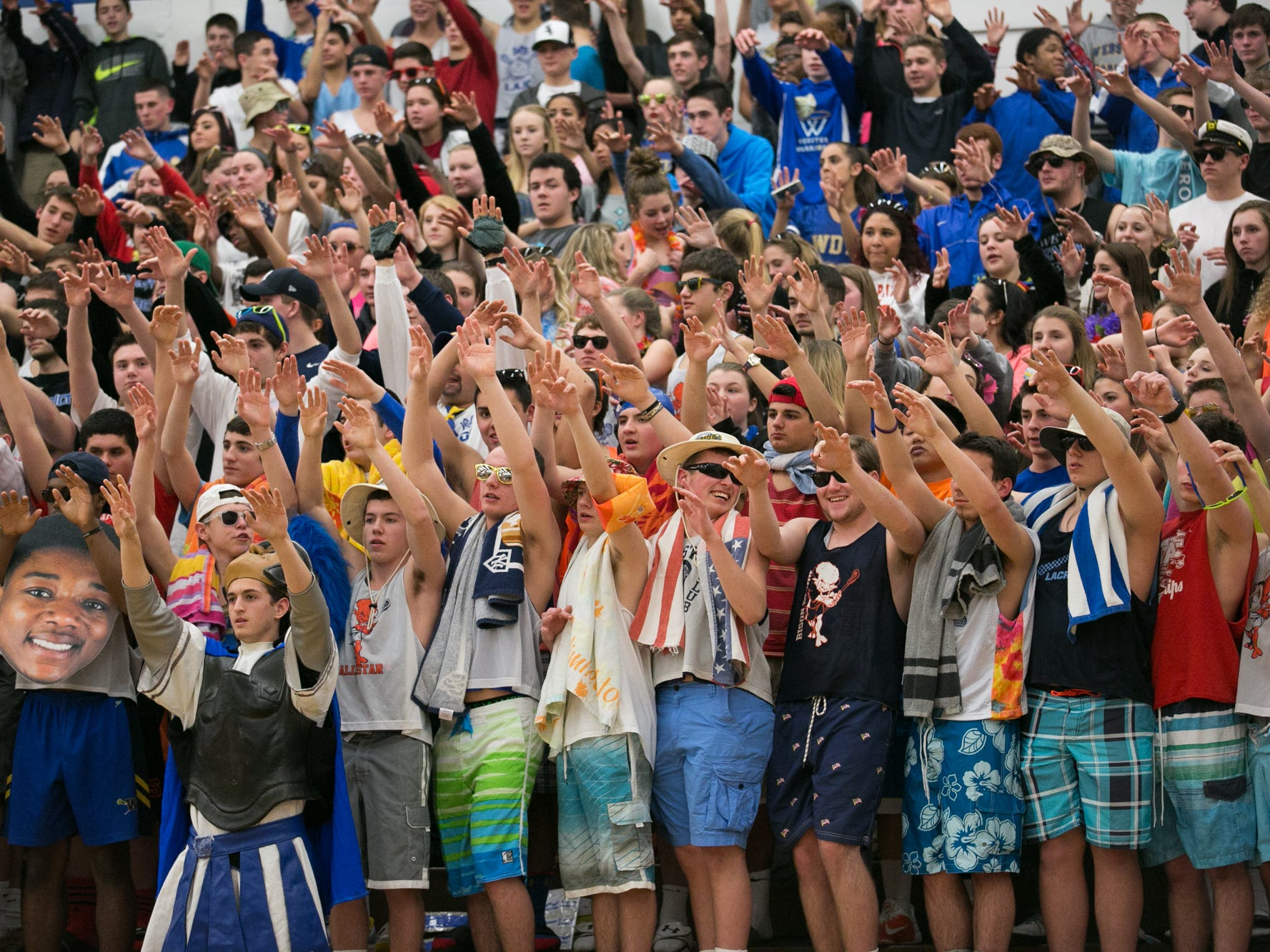 Webster Schroeder fans cheer during a game against Greece Athena on Friday.