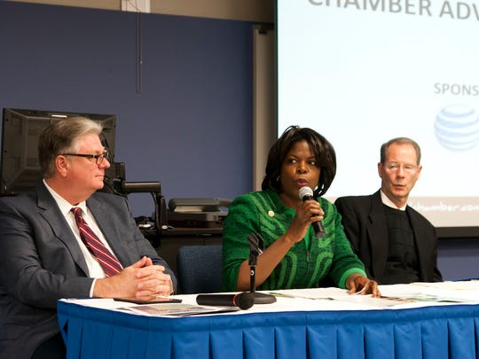 FAMU President Elmira Mangum, center, Tallahassee Community College president Jim Murdaugh, left, and Florida State University's David Coburn discuss in February 2015 the interests of each university that legislative session.